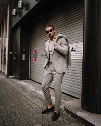 How to wear: grey overcoat, beige wool suit, beige crew-neck sweater, dark brown suede loafers