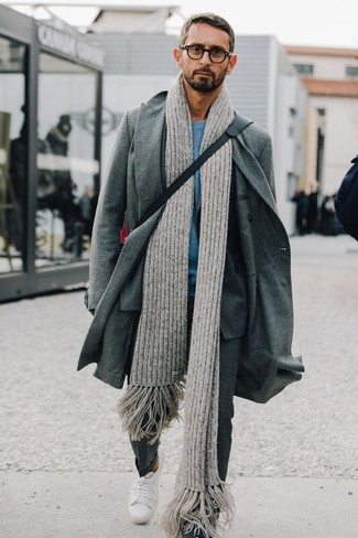 This combination of a grey overcoat and a Moncler men's Wool Scarf is the picture of elegance. A good pair of white low top sneakers are sure to leave the kind of impression you want to give. This ensemble is a pretty wonderful idea, especially for fall, when the mercury is dropping.