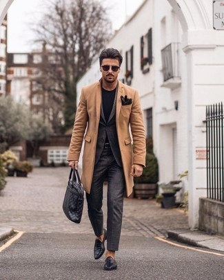 Belt Outfits For Men: To create a casual look with a contemporary twist, you can rely on a camel overcoat and a belt. Add black leather tassel loafers to the mix for an element of refinement.