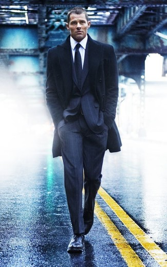 Pair A Black Overcoat With Deep Blue Vertical Striped Suit To Ooze Class And Sophistication
