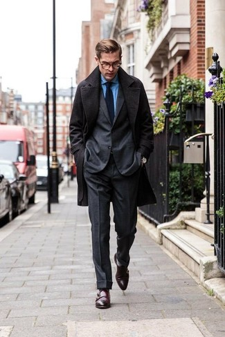 How to wear: charcoal overcoat, charcoal wool suit, blue chambray dress shirt, dark brown leather double monks