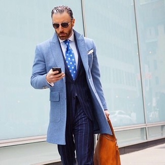 How to wear: light blue overcoat, navy vertical striped suit, white dress shirt, tobacco leather tote bag