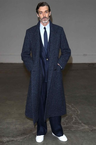 How to wear: navy herringbone overcoat, navy suit, white dress shirt, white low top sneakers