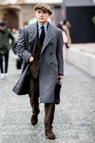 How to Wear a Black Leather Briefcase: If you feel more confident wearing something comfortable, you'll like this city casual combo of a grey overcoat and a black leather briefcase. Put an elegant spin on an otherwise simple outfit by sporting a pair of brown suede derby shoes.
