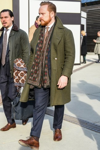 How to Wear Oxford Shoes: One of the smartest ways to style out such a hard-working menswear piece as an olive overcoat is to combine it with a navy vertical striped suit. When it comes to shoes, this outfit is rounded off well with oxford shoes.