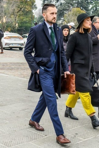 How to Wear a Navy Overcoat: This combo of a navy overcoat and a blue suit couldn't possibly come across as anything other than outrageously stylish and refined. Look at how well this look is rounded off with a pair of brown leather oxford shoes.