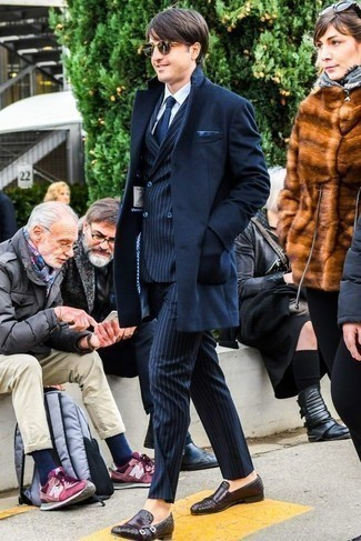 How to Wear a Navy Overcoat: This pairing of a navy overcoat and a navy vertical striped suit is a safe option when you need to look like a refined gent. Dark brown woven leather loafers look awesome here.