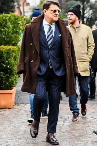 How to Wear Dark Brown Leather Oxford Shoes: This sophisticated pairing of a dark brown overcoat and a navy vertical striped suit is a common choice among the dapper chaps. Dark brown leather oxford shoes look great finishing off this ensemble.