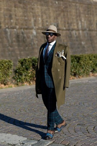 How to Wear an Olive Overcoat: Consider teaming an olive overcoat with a navy check suit if you're going for a neat, stylish look. A pair of brown suede double monks can integrate effortlessly within a myriad of ensembles.