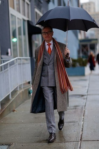 Fashion for Men Over 50: What To Wear: Make a jaw-dropping statement anywhere you go in a grey overcoat and a grey plaid suit. With shoes, you could follow the casual route with a pair of dark brown leather desert boots. This is a good-looking yet age-appropriate ensemble for an over-50 man.