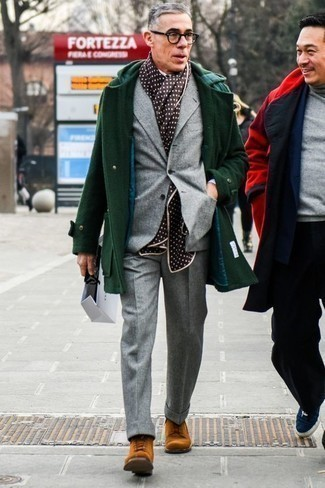 500+ Outfits For Men After 50: Marrying a dark green overcoat and a grey suit will allow you to exhibit your outfit coordination savvy. Send this ensemble in a less formal direction by slipping into tobacco suede casual boots. Looking for dressing tips for older men? This getup should definitely go to your inspiration folder.