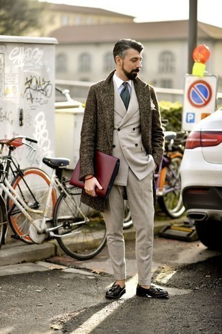 Dark Brown Overcoat Outfits: Teaming a dark brown overcoat and a beige suit is a guaranteed way to infuse your day-to-day fashion mix with some masculine elegance. Get a little creative when it comes to footwear and complete this look with black leather tassel loafers.