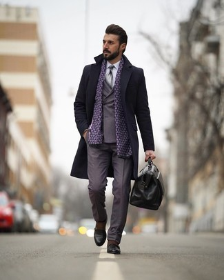 Grey Suit Outfits: One of the most elegant ways to style such a timeless menswear piece as a grey suit is to marry it with a black overcoat. For something more on the cool and laid-back side to complete your outfit, complement your outfit with black leather double monks.