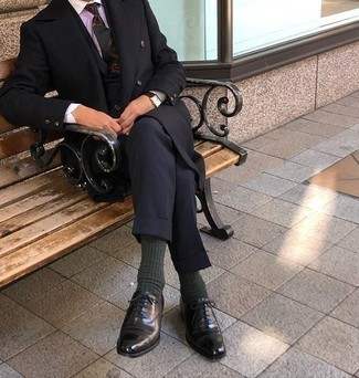 Black Overcoat Outfits: We're loving the way this pairing of a black overcoat and a navy suit instantly makes you look sharp and polished. Black leather oxford shoes look perfect here.