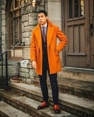 Men's Outfits 2020: We're loving the way this combination of an orange overcoat and a navy corduroy suit instantly makes any gentleman look refined and dapper. Red leather double monks are an effortless way to infuse a touch of stylish nonchalance into your getup.