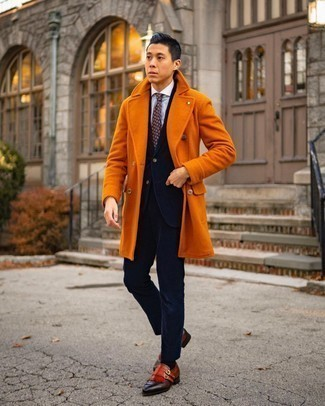 Navy Corduroy Suit Outfits: Putting together a navy corduroy suit with an orange overcoat is an awesome idea for a classic and refined ensemble. For something more on the daring side to finish your ensemble, complete this outfit with tobacco leather double monks.