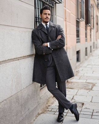 Charcoal Suit Chill Weather Outfits: Try teaming a charcoal suit with a charcoal overcoat for devastatingly stylish attire. A good pair of black leather double monks is the simplest way to give a dash of stylish nonchalance to this look.