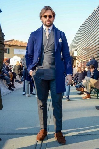 Charcoal Suit Outfits In Their 30s: This classy combo of a charcoal suit and a navy overcoat is a must-try ensemble for today's man. You can get a little creative with footwear and tone down your getup by wearing brown suede double monks. This combination is most probably exactly what you've been looking for as a young guy.