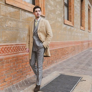 Coat Outfits For Men: Irrefutable proof that a coat and a grey vertical striped suit are awesome when teamed together in a sophisticated getup for today's man. For something more on the classy side to finish off this ensemble, introduce dark brown suede tassel loafers to the mix.