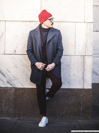 How to Wear a Burgundy Suit In Fall: This combo of a burgundy suit and a navy overcoat epitomizes sophistication and refinement. To inject a more relaxed touch into this ensemble, add a pair of white leather low top sneakers to the mix. As you can see here, it's very easy to look stylish and stay comfortable when chillier days are here, all thanks to combos like this.