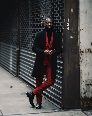 How to Wear a Burgundy Suit In Cold Weather: You'll be surprised at how very easy it is to put together this refined outfit. Just a burgundy suit and a navy overcoat. Black leather loafers will give a playful vibe to an otherwise mostly dressed-up look. This pairing demonstrates that as a 30-something man, you have a wide range of sartorial options.