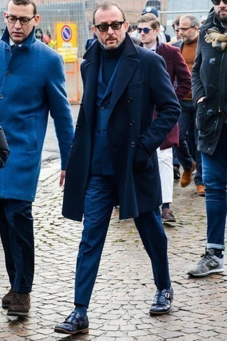 How to Wear a Navy Overcoat: A navy overcoat and a blue suit are absolute staples if you're picking out a refined wardrobe that holds to the highest menswear standards. For footwear, go down the casual route with a pair of navy leather monks.