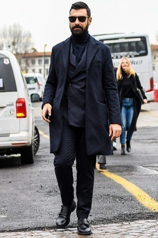 How to Wear Black Leather Double Monks: Rock a navy overcoat with a navy vertical striped suit for rugged refinement with a modern twist. A pair of black leather double monks is a great choice to finish off your getup.