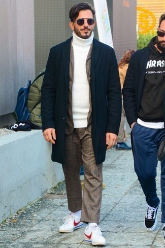 White and Red Leather Low Top Sneakers Cold Weather Outfits For Men: You'll be surprised at how easy it is to get dressed like this. Just a navy overcoat and a brown suit. A pair of white and red leather low top sneakers can easily dial down a dressy look.