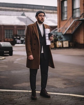 How to Wear a Black Suit: Make a black suit and a brown overcoat your outfit choice for incredibly stylish style. For a more casual take, why not introduce dark brown leather casual boots to the mix?