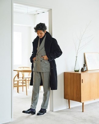 Black Overcoat Outfits: A black overcoat and a black and white houndstooth suit are an incredibly stylish outfit for you to try. All you need now is a pair of black leather loafers.