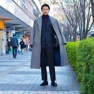 Men's Outfits 2020: A modern gent's refined wardrobe should always include such mainstays as a white and black houndstooth overcoat and a navy vertical striped suit. Complete your look with a pair of navy leather tassel loafers and you're all set looking dashing.