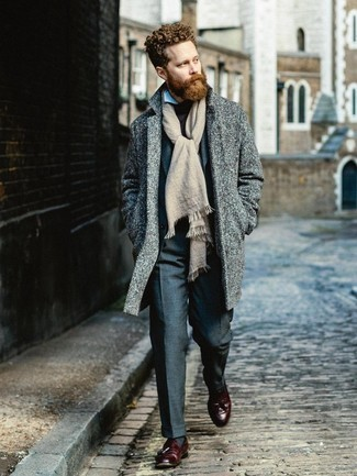 Charcoal Suit Winter Outfits: We're loving the way this pairing of a charcoal suit and a grey overcoat immediately makes any man look elegant and dapper. For a more casual vibe, complement this outfit with a pair of burgundy leather tassel loafers. During the winter months, when functionality is paramount, it can be easy to settle for a less-than-stylish look. However, this look is a stark illustration that you can actually stay comfy and remain equally stylish in the winter months.