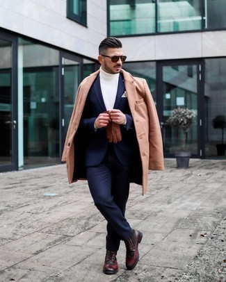 Brogue Boots Outfits: This is undeniable proof that a camel overcoat and a navy suit are amazing when combined together in a refined look for a modern dandy. Complement your getup with brogue boots to give a touch of stylish casualness to your ensemble.