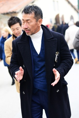 How to wear: navy overcoat, navy suit, navy waistcoat, white turtleneck