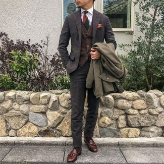 Brown Houndstooth Overcoat Outfits: Wear a brown houndstooth overcoat and a charcoal wool suit for a really sharp outfit. Brown leather tassel loafers are a nice idea to finish off your outfit.