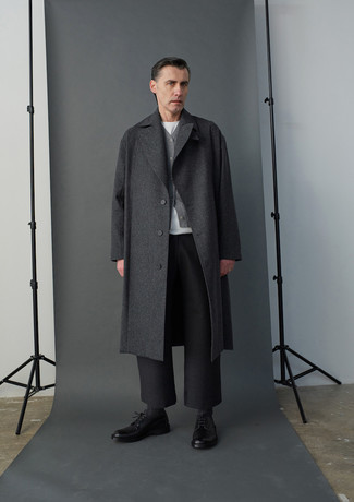 Charcoal Overcoat Outfits: Such staples as a charcoal overcoat and charcoal wool chinos are an easy way to infuse extra sophistication into your off-duty routine. Hesitant about how to round off this outfit? Finish off with black leather derby shoes to bump up the wow factor.