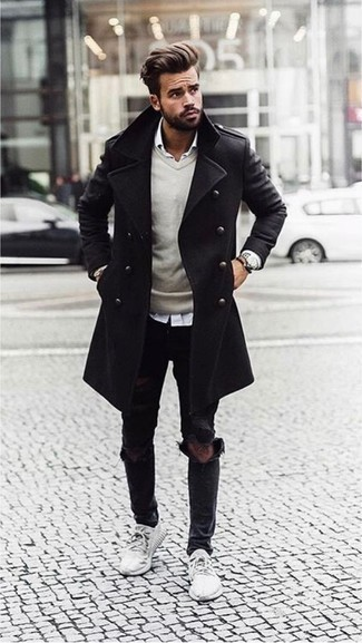 How to Wear Black Jeans For Men: This relaxed pairing of a black overcoat and black jeans is super easy to pull together in no time flat, helping you look seriously stylish and ready for anything without spending too much time rummaging through your wardrobe. A pair of grey athletic shoes easily amps up the appeal of your ensemble.