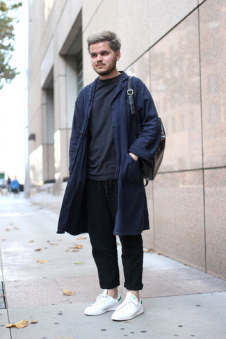 How to wear: navy overcoat, black sweatshirt, black linen chinos, white leather low top sneakers