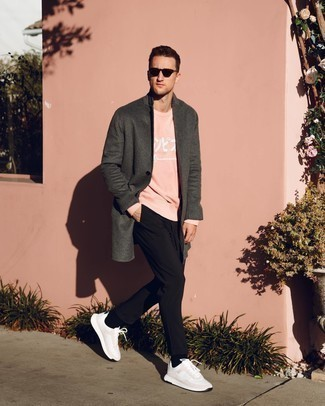 Sweatshirt Outfits For Men: Consider teaming a sweatshirt with black chinos for a straightforward ensemble that's also put together. Let your expert styling really shine by rounding off your getup with white athletic shoes.