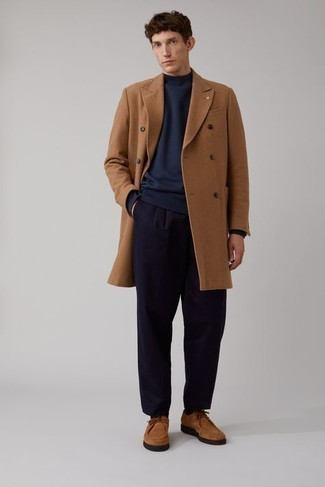 1200+ Smart Casual Outfits For Men: This pairing of a navy sweatshirt and navy chinos looks amazing and makes you look infinitely cooler. When not sure about the footwear, complement this outfit with a pair of tobacco suede desert boots.