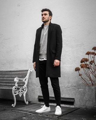 How to Wear a Black Overcoat: This combination of a black overcoat and black chinos is ideal when you need to look dapper but have no time to craft a look. To add a dash of stylish casualness to this outfit, complete this ensemble with white canvas low top sneakers.