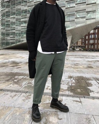 How to wear: black overcoat, black sweatshirt, white long sleeve shirt, green chinos