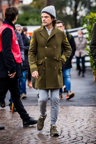 How to wear: olive overcoat, grey sweatshirt, white long sleeve shirt, grey sweatpants