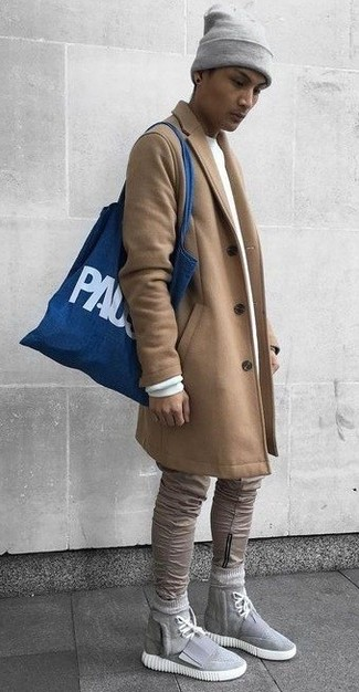 How to wear: camel overcoat, white sweatshirt, khaki skinny jeans, grey canvas high top sneakers