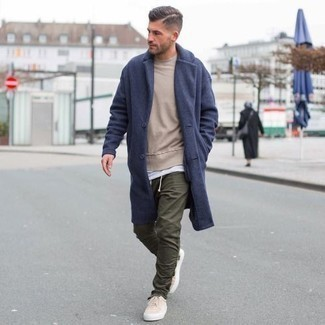 How to Wear a Navy Overcoat: For laid-back sophistication with a masculine spin, you can easily go for a navy overcoat and olive chinos. And if you wish to effortlessly dial down your getup with one single piece, why not introduce a pair of beige canvas low top sneakers to this getup?