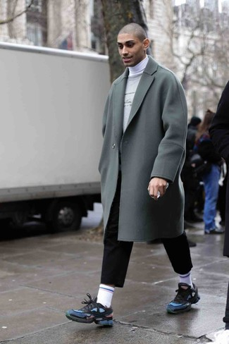 How to Wear a Grey Overcoat: Pairing a grey overcoat and black chinos is a fail-safe way to inject your styling rotation with some manly elegance. For something more on the casual and cool side to round off your getup, complement your outfit with navy athletic shoes.