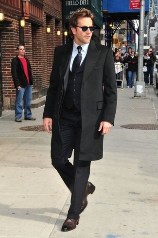 How to wear: black overcoat, black three piece suit, white dress shirt, dark brown leather brogues
