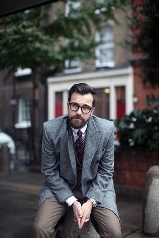 How to wear: grey plaid overcoat, brown three piece suit, white dress shirt, burgundy polka dot tie