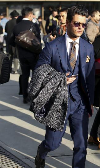 How to wear: charcoal herringbone overcoat, navy check three piece suit, white dress shirt, grey plaid tie