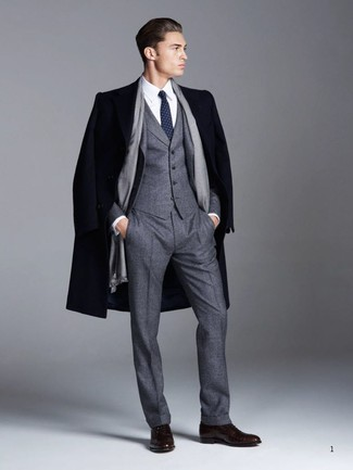 How to wear: navy overcoat, charcoal wool three piece suit, white dress shirt, dark brown leather oxford shoes